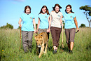 Girls walking with a lioness
