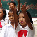 Children raising their hands in the air