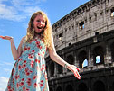 GIrl posing in front of Rome's ancient ruins