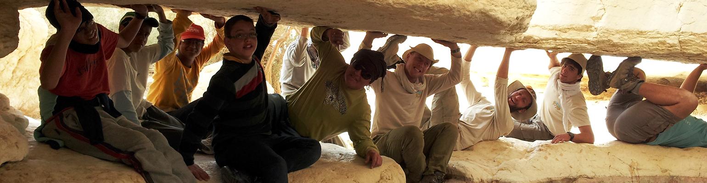 Free Spirit participants under a rock formation