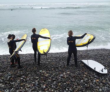 Learning to Surf at Pukana Surf Schools.
