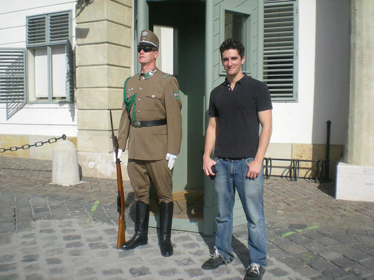 Study abroad student posing with a Castle Guard in Budapest, Hungary