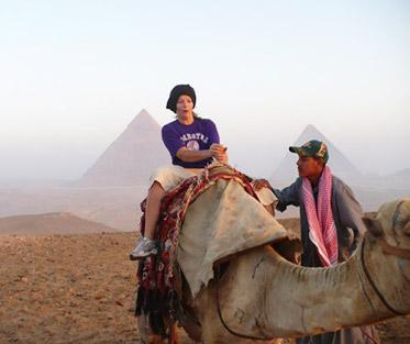 Katherine exploring the pyramids of Giza by camel!