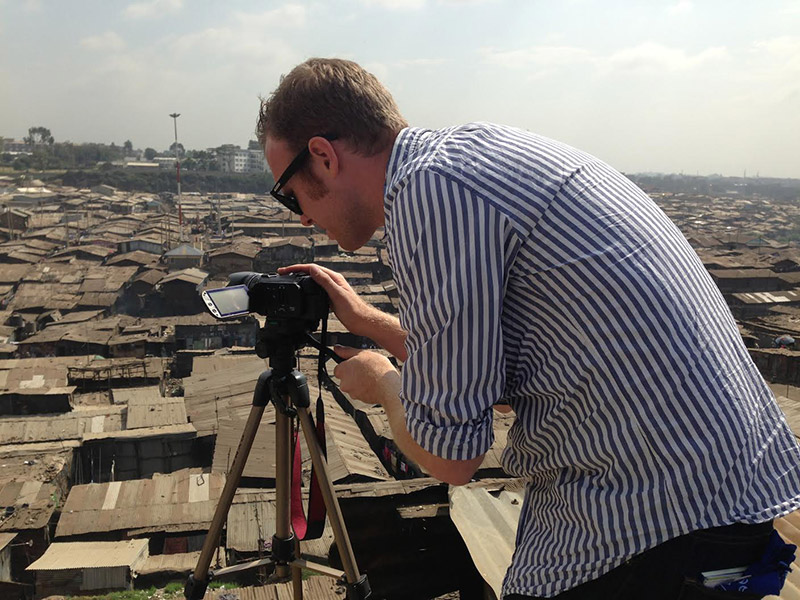 A person filming a documentary in the Mathare slum of Nairobi, Kenya.