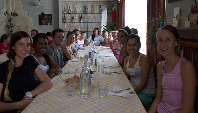 Camp counselors having lunch in Italy