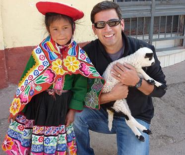 Visiting Cusco, Peru posing with a Peruvian child