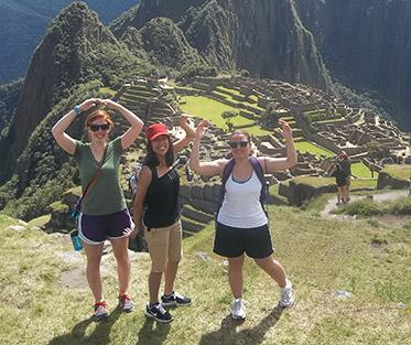 Jessie and her friends making the OSU sign at Machu PIcchu.