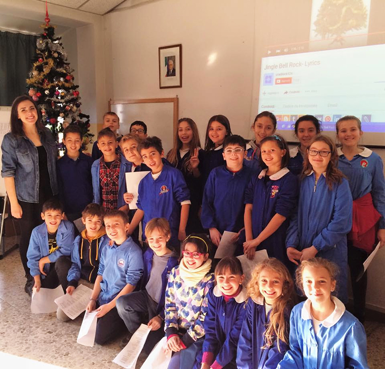 International teacher with her students in Italy