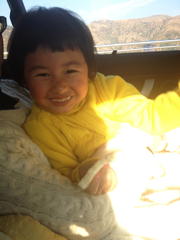 A young Chinese girl in a car