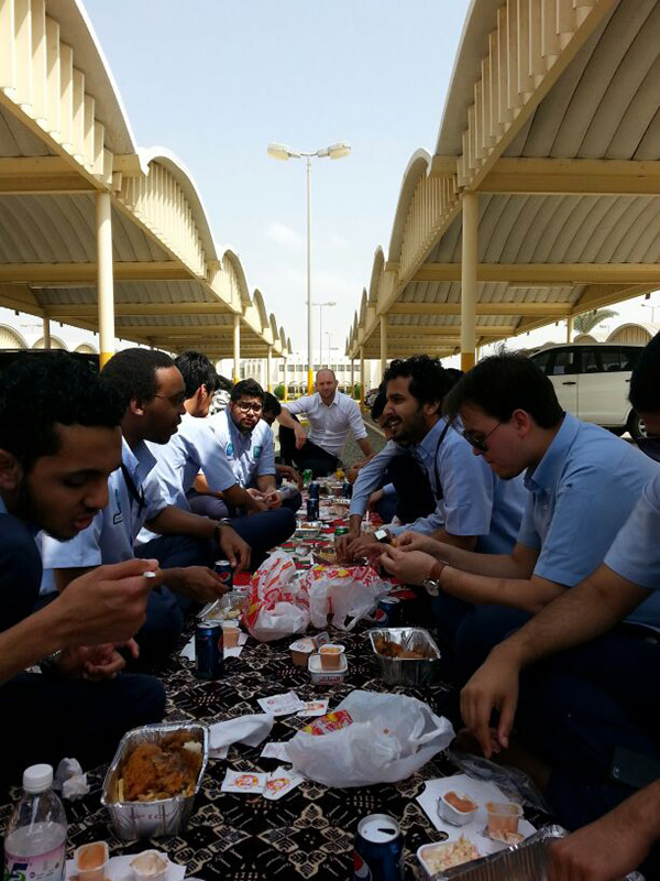 English teacher eating lunch with students in Jeddah, Saudi Arabia
