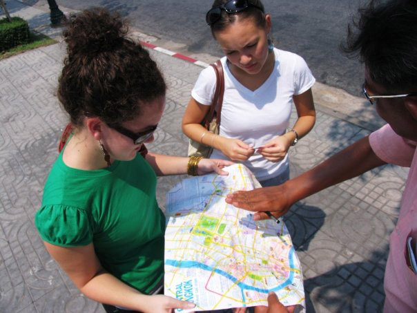 Study abroad students looking at a map