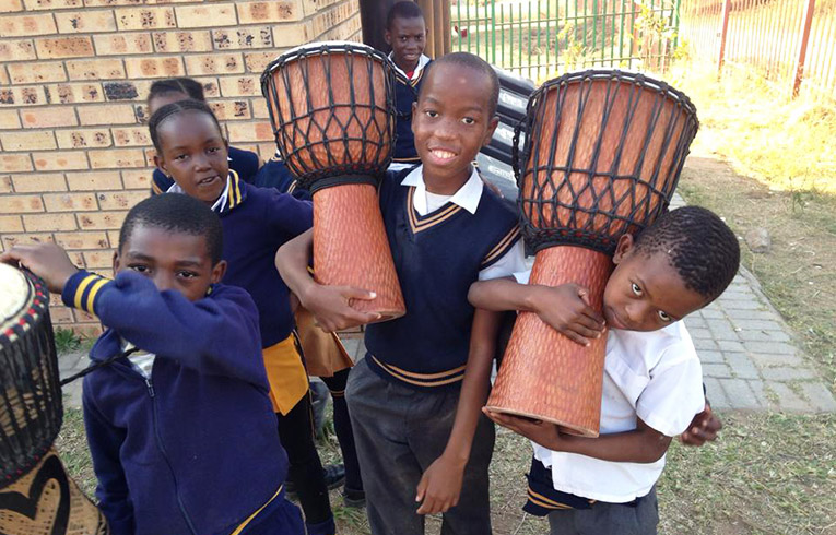 Students with djembes in White River South Africa