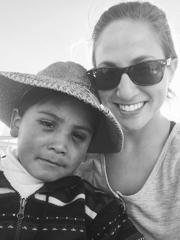 Volunteer with a local child in Peru