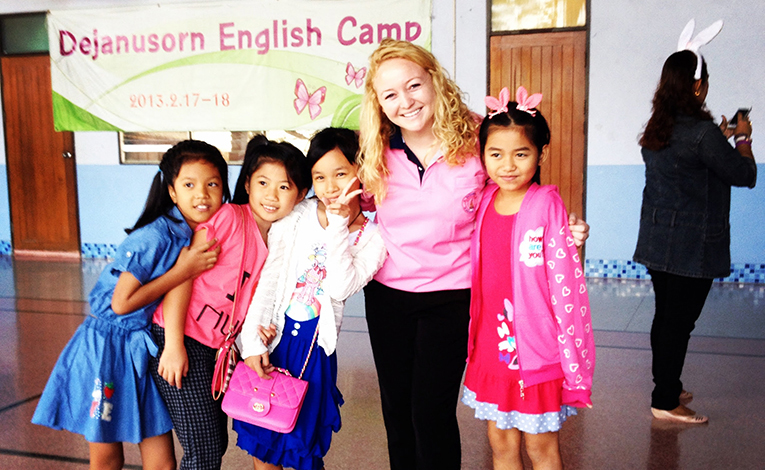 American teacher with Thai students in Thailand