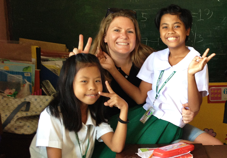 Volunteer with school children in Laos