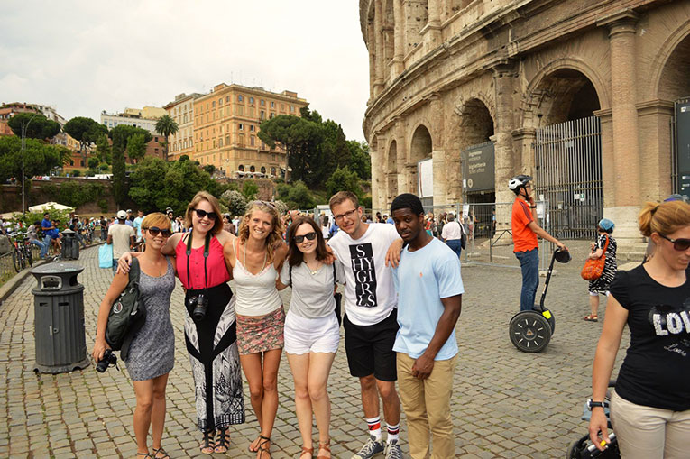 Tourists at Flavian Amphitheater in Naples, Italy
