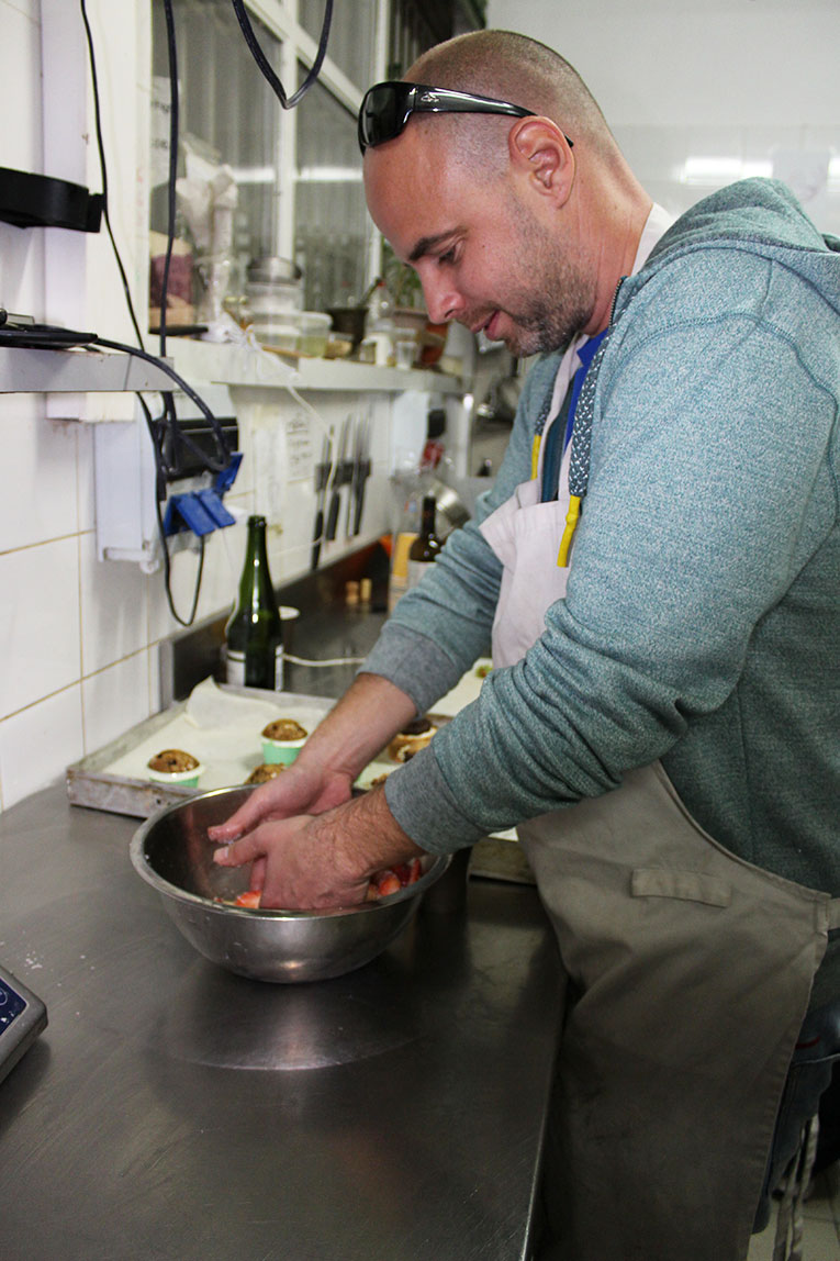 Man mixing ingredients at a Vegan Bakery in Tel Aviv, Israel
