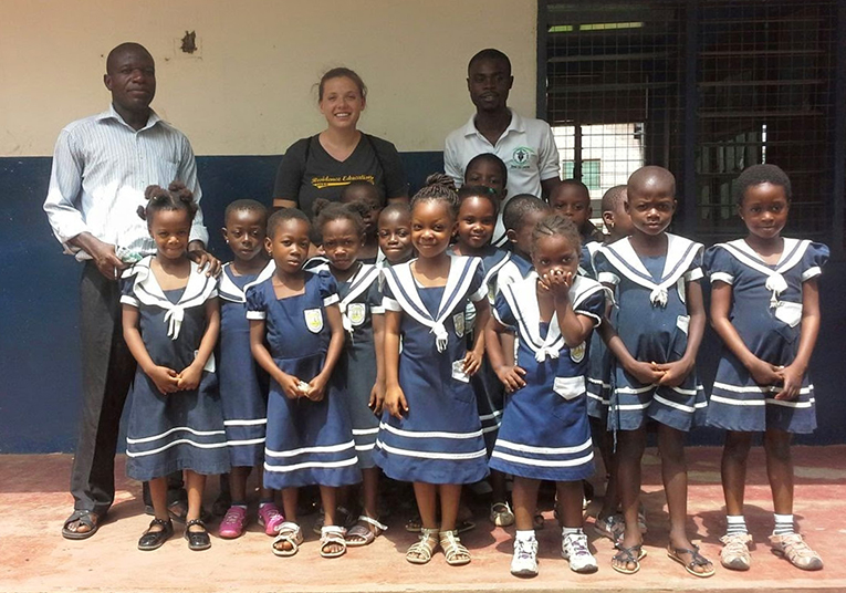 Medical volunteers with local children and clinic staff in Ghana