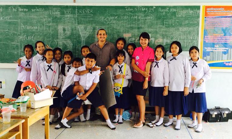 Volunteer teacher with students in Thailand