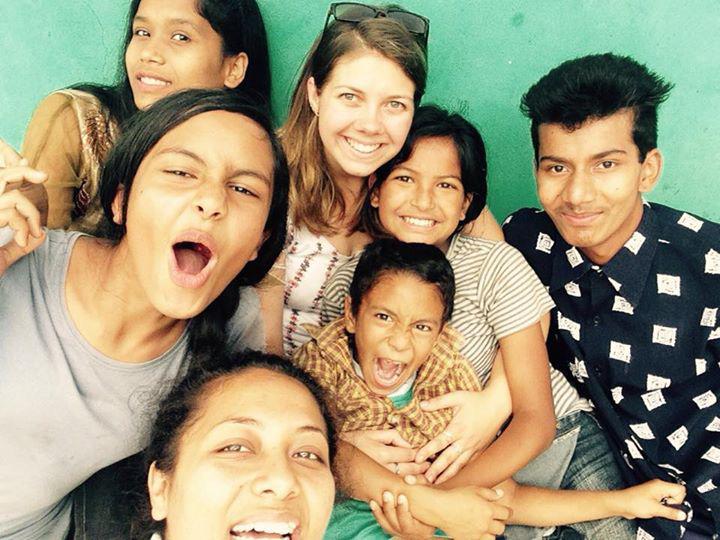 Volunteer with children in Nepal