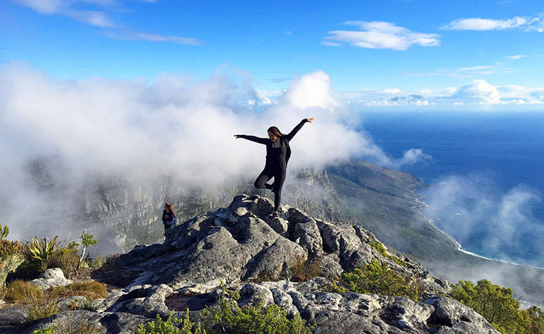 Girl standing at the top of Table Mountain in Cape Town, South Africa