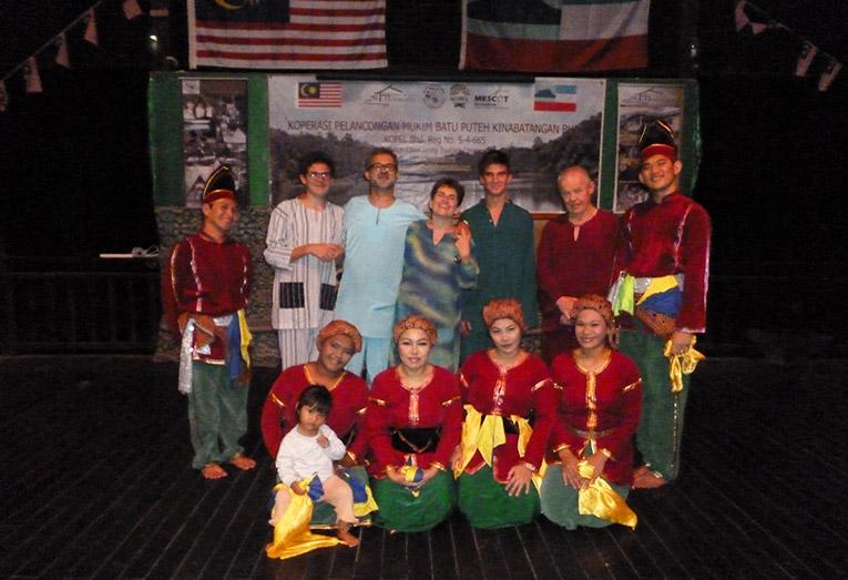 Native dancers in Borneo with international volunteers