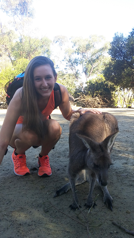 Tourist with a kangaroo in Australia
