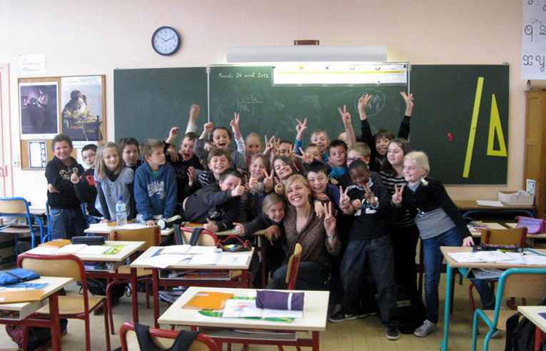 Teacher in Luneville, France with local students