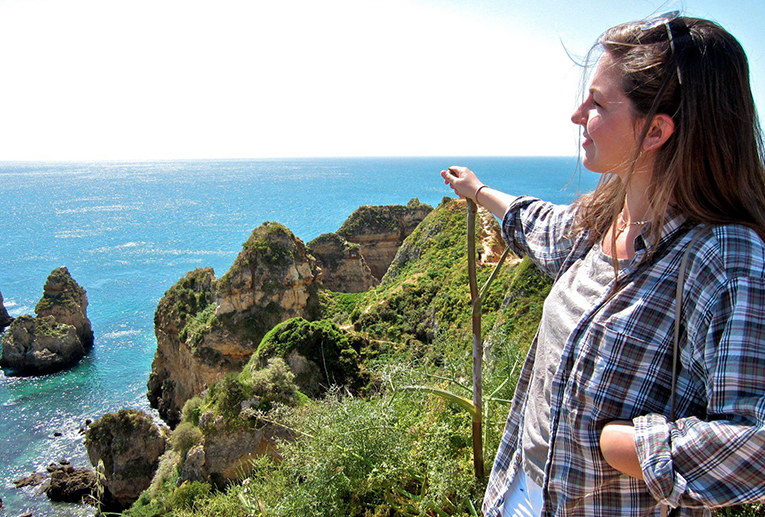 Hiking along cliffs in Lagos, Portugal