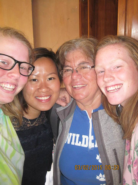 Volunteers with host mother in Ecuador