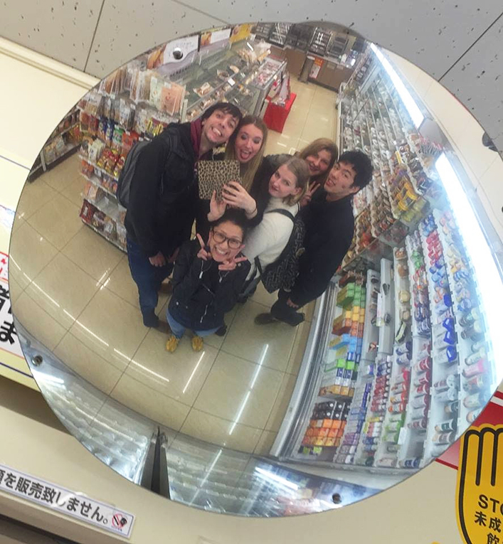 Friends taking a picture at a grocery in Japan