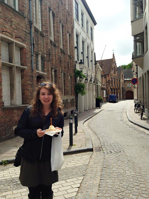 Eating waffles on a street in Belgium