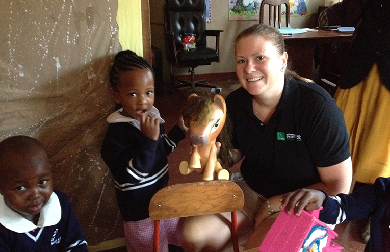 Volunteer with children in Uganda