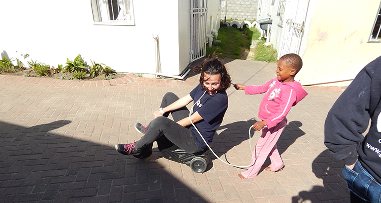 Volunteer playing with a child in South Africa
