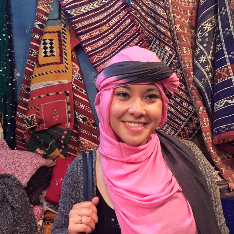 Girl wearing traditional dress in Chefchaouen, Morocco