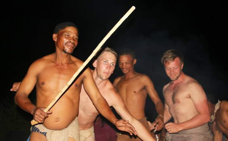 Bushmen in Botswana dancing with international volunteers