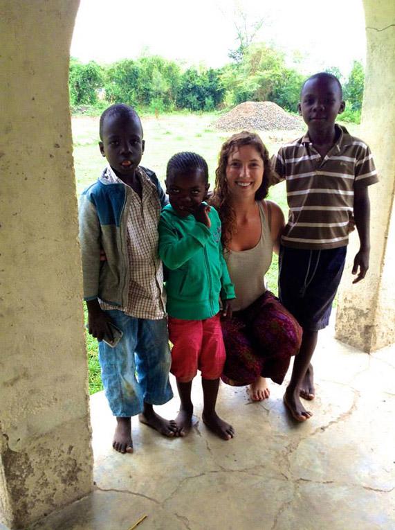 Volunteer with local children in Kenya