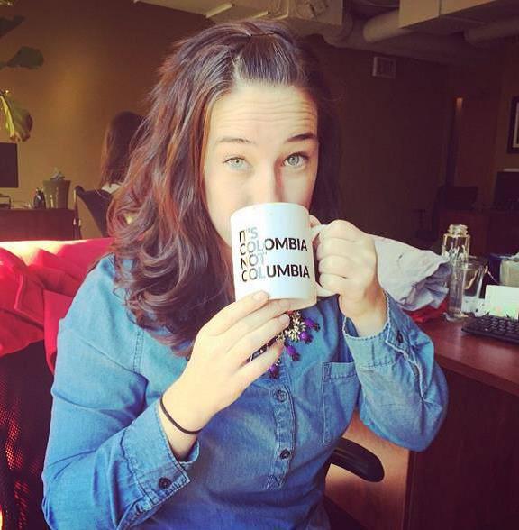 Woman drinking from a coffee mug
