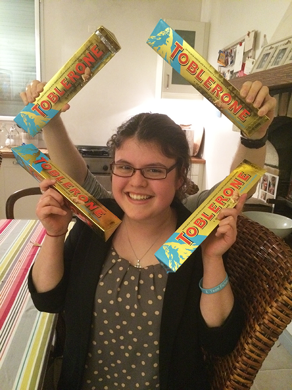 Girl surrounded by Toblerone chocolate