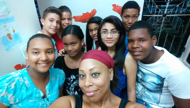 International teacher and students in the Dominican Republic