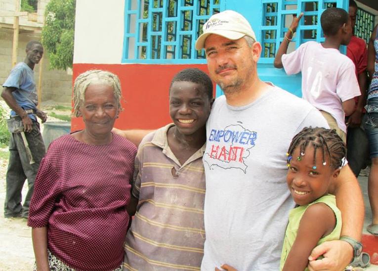 Construction volunteer in Haiti with locals