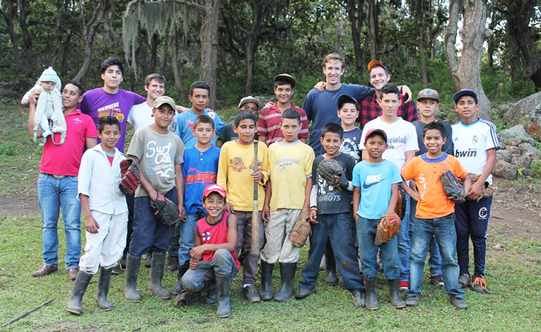 American student playing baseball with kids in Nicaragua