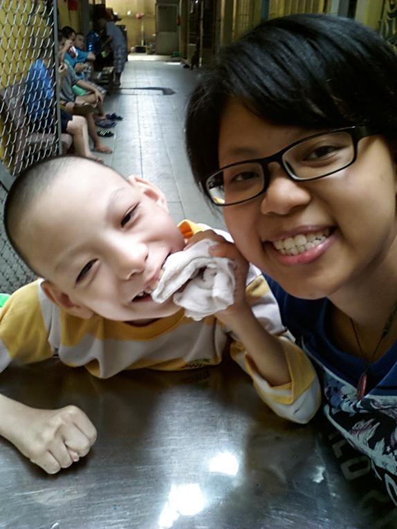 Volunteer with young boy in Vietnam