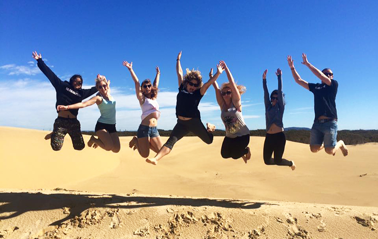 Jumping photo of friends at Basecamp in Australia