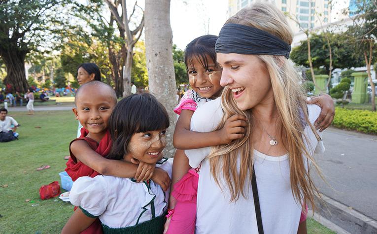 Volunteer with children at a park in Yangon, Myanmar
