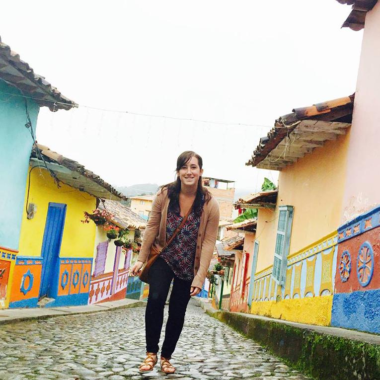 Girl walking down a street in Guatape, Colombia