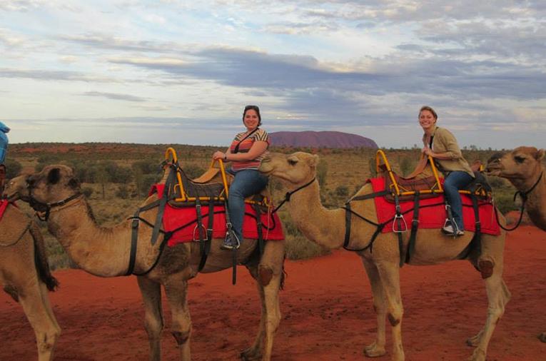 Riding camels near Uluru in Australia