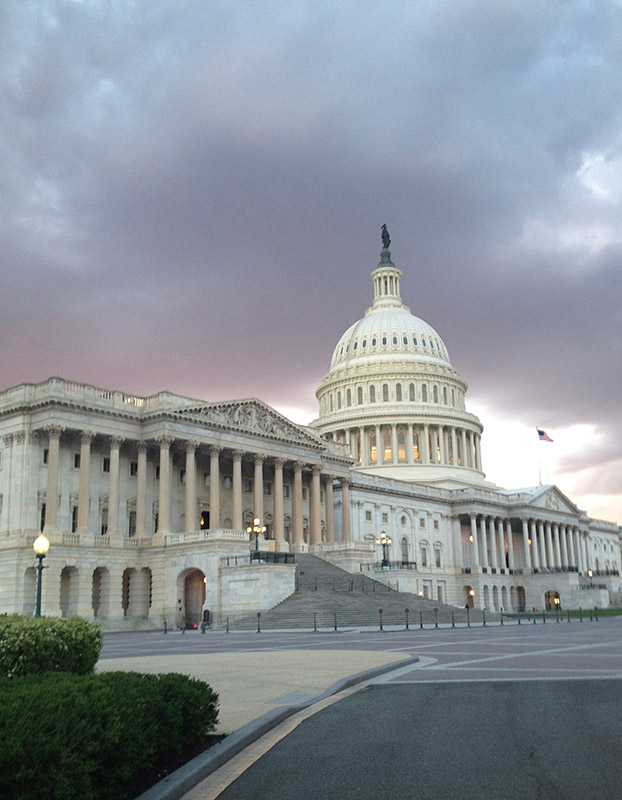 A dramatic photo of the United States Capitol Building in Washington D.C.