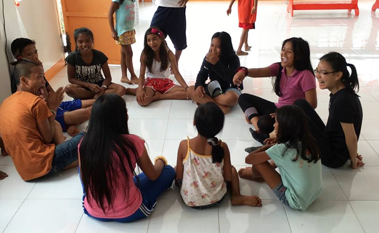 Children and teens at a community center in the Philippines