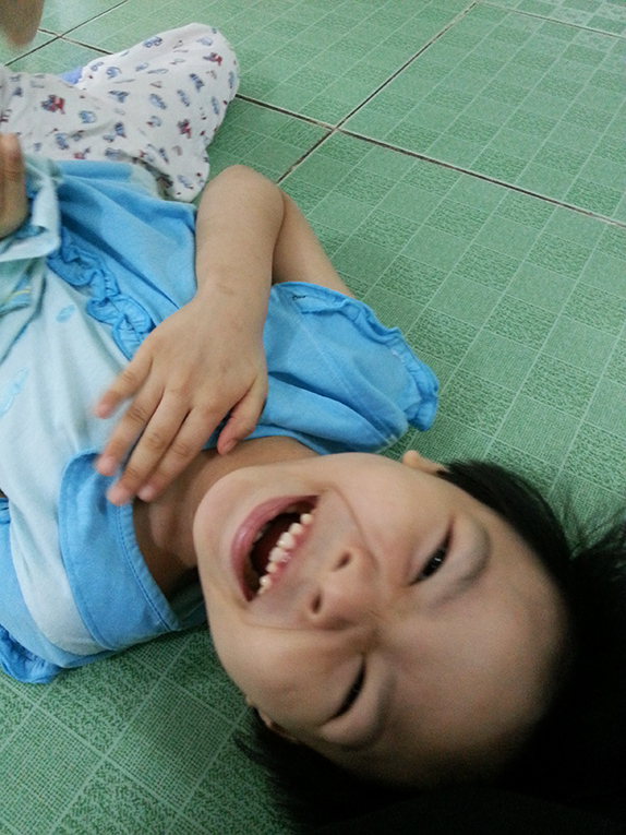 A five-year-old orphan smiling in Vietnam